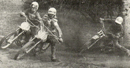 Two riders make tracks to get out of a corner while a third seems to have gotten hung up in transit. Czerwinski photo.