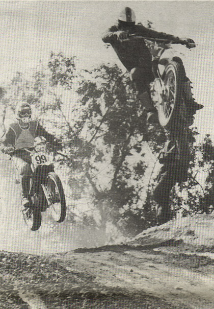 Now that's what you call WFO over the jumps. Dave Foltz really soars on his Wheelsmith Maico while he passes Rich Mullin. Wonder how he landed? So do we.   Klugman photo.
