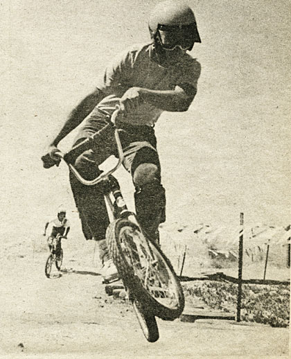 This rider makes a mid-air correction in mid-air. No? Well how about, this is a bicycle rider in the air, off the ground, in the sky. Kimball photo.