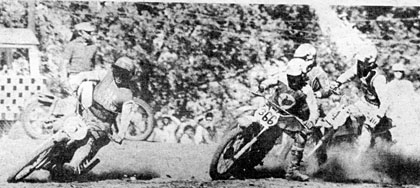 Jeff Blix slides his Bultaco into the first corner trying to take the N.B.R. ace on the inside. Behind Jeff are Rick Salmon and Don Hicks. Kiel photo.